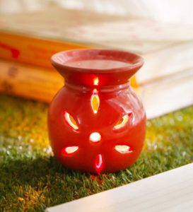 Pepperfry - Buy Red Ceramic & Wax Aroma Candle Diffuser Rose Oil by Riflection at Rs 79 only