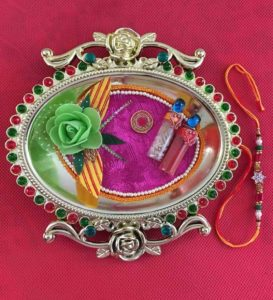 Pepperfry- Buy Golden Thali With Rakhi and Tilak at Rs 179